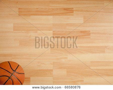 An Official Orange Ball On A Hardwood Basketball Court