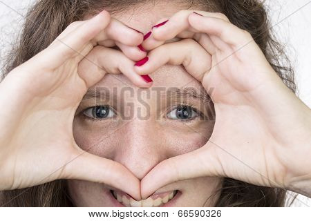 Teen With Hands In Heart Shape
