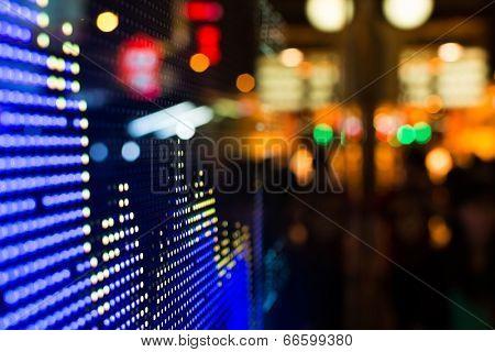 Hong Kong stock market price display at street in the night.