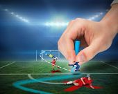 Digital composite of hand drawing tactics on football pitch during match poster