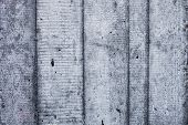 Grey concrete wall with hardened traces of the shuttering moulds. poster