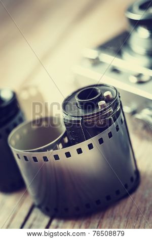 Old Photo Film Rolls, Cassette And Retro Camera On Background.