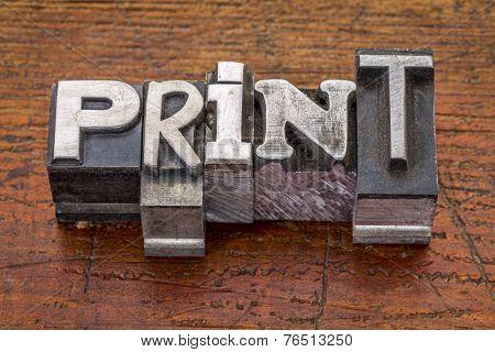 print word in vintage metal type printing blocks over grunge wood