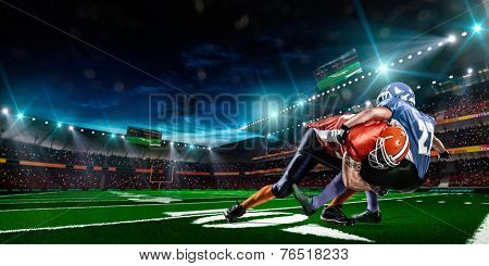 American football player in action on stadium