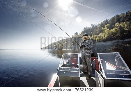 Men is fishing on the boat