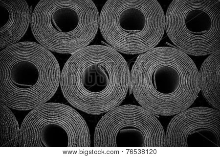 Closeup of Rolls of new black roofing felt or bitumen. Slight vignette