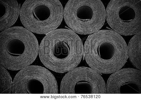 Closeup of Rolls of new black roofing felt or bitumen. Slight vignette