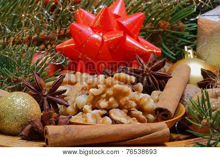 Walnuts and star anise with cinnamon sticks and christmas decoration poster