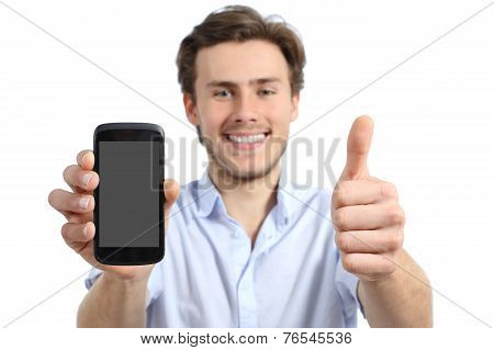Young Man Showing A Blank Smart Phone Screen With Thumbs Up