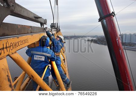 Working Jib Of Tower Crane Is Installed  With Mobile Crane.