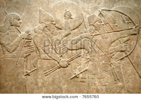 Assyrian 8th century BC relief showing Assyrian soldiers in battle poster