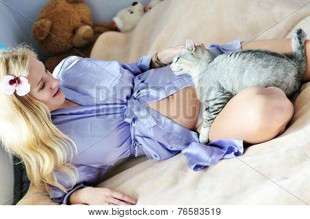 Caressing Pet Of Pregnant Woman
