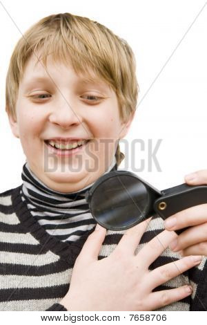 A Boy And A Magnifying Glass