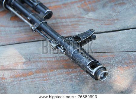 Closeup automatic rifle Kalashnikov AK 47 on a wooden table. Shallow depth of field. poster