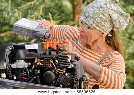 Senior Woman Changing Engine Oil
