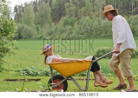 Seniors With Wheelbarrow