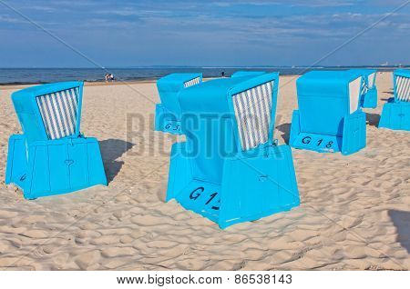 Hooded beach chairs (strandkorb) at the Baltic seacoast in Swinoujscie city Poland poster