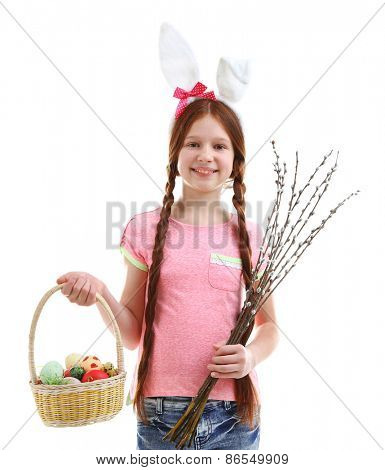 Beautiful little girl holding wicker basket with Easter eggs and pussy-willow branches, isolated on white poster