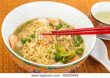 Eating Shrimp And Noodles Soup