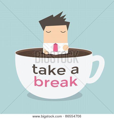 Businessman take a break in a coffee cup