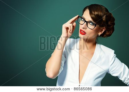 Close-up portrait of a gorgeous young woman wearing glasses. Beauty, fashion. Make-up. Optics, eyewear.