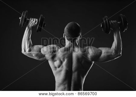 Man makes exercises dumbbells. Sport, power, dumbbells, tension, exercise. Article about fitness and sports.Gym and fitness concept - bodybuilder and dumbbell over black. poster