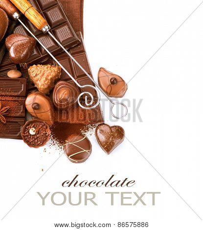Chocolates border isolated on white background. Chocolate. Assortment of fine chocolates in white, dark, and milk chocolate. Variety of Praline Chocolate sweets