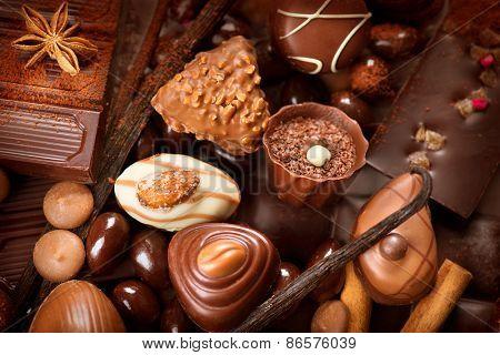 Chocolates background. Chocolate. Assortment of fine chocolates in white, dark, and milk chocolate. Praline Chocolate sweets