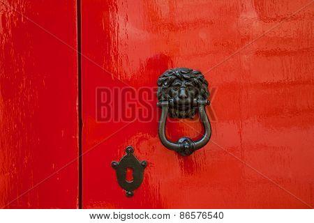Old Red Door With Lion Head Metal Knockers