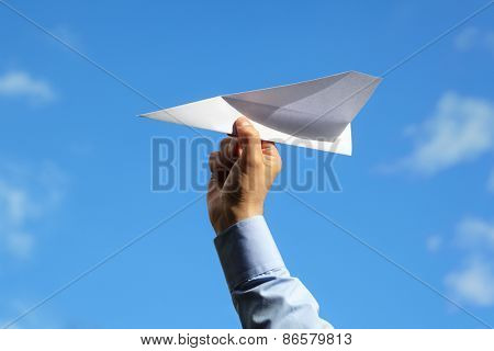 Businessman launching a paper airplane concept for business startup, entrepreneur, creativity and freedom