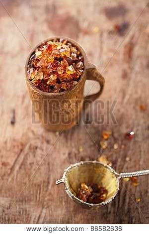 Gum arabic, also known as acacia gum - in wooden mug poster