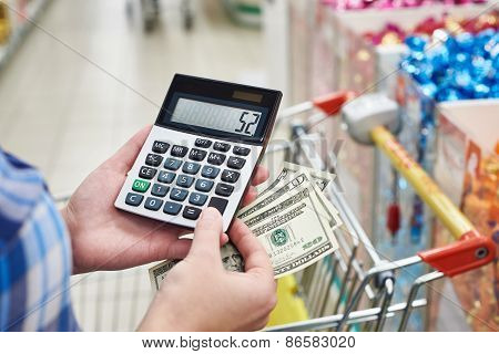 Housewife Considers Costs In Store