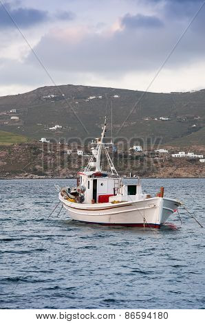 Classic Fishing Boat In The Sea. Greece. Mykonos.