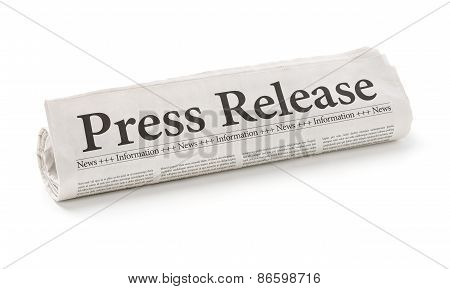 Rolled Newspaper With The Headline Press Release