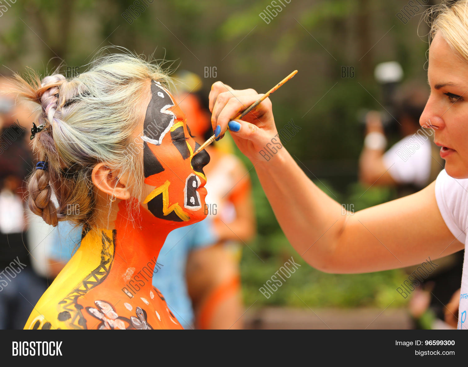 NEW YORK - JULY 18, 2015:Model during second NYC Body Painting Day in  midtown Manhattan featuring artist Andy Golub in New York.Artists paint 100  fully nude ...