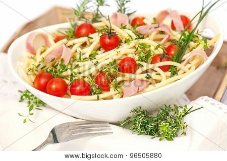 Portion of salad with noodles,herb and tomatoes
