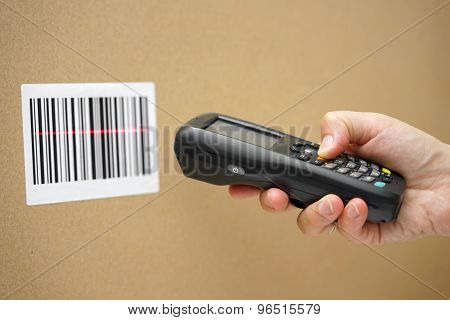 Scanning Label On The Box With Barcode Scanner