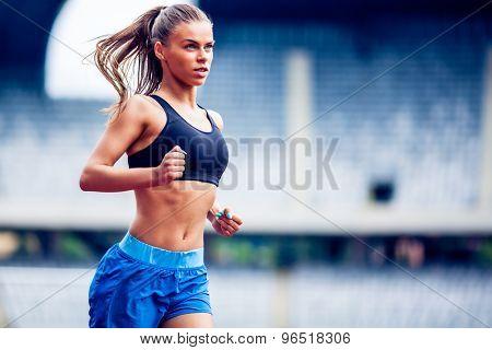 Fitness woman on stadium running