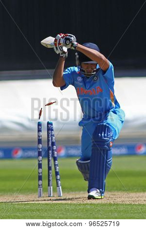 CARDIFF, WALES - June 04 2013: India's Rohit Sharma is bowled out by Australia's Clint McKay (not pictured) during the ICC Champions Trophy warm up match between India and Australia