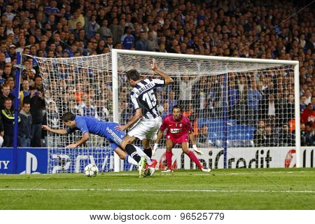 LONDON, ENGLAND. September 19 2012 Chelsea's midfielder Eden Hazard is fouled by Juventus's defender Andrea Barzagli during the UEFA Champions League football match between Chelsea and Juventus