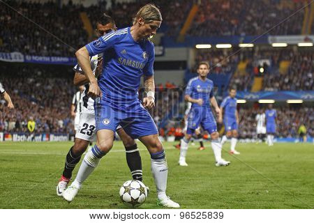 LONDON, ENGLAND. September 19 2012 Juventus's midfielder Arturo Vidal  and Chelsea's Spanish forward Fernando Torres during the UEFA Champions League football match between Chelsea and Juventus