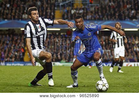 LONDON, ENGLAND. September 19 2012 Juventus's Italian defender Andrea Barzagli and Chelsea's English defender Ashley Cole during the UEFA Champions League football match between Chelsea and Juventus