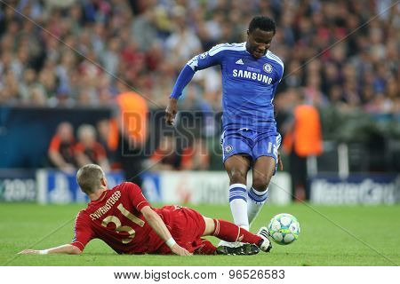 MUNICH, GERMANY May 19 2012. Bayern's German midfielder Bastian Schweinsteiger  and Chelsea's Nigeria midfielder John Obi Mikel in action during the 2012 UEFA Champions League Final