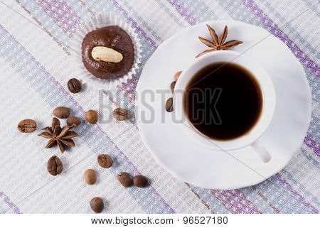 Cup of coffee with almond cakes