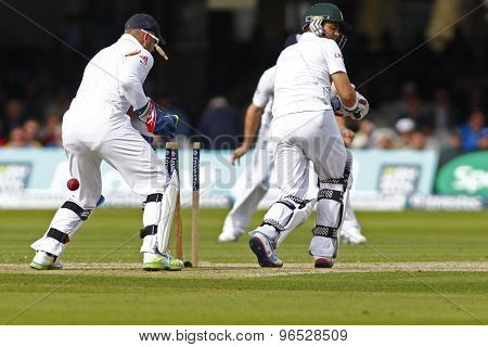 LONDON, ENGLAND. AUGUST 16 2012 South Africa's Jacques Rudolph is bowled by England's Graeme Swann  during the third Investec cricket  test match between England and South Africa, at Lords Ground