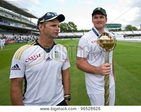 LONDON, ENGLAND. AUGUST 20 2012 South Africa manager Gary Kirsten and Graeme Smith with the Mace for becoming the No1 test team in the world after winning the third test match against England