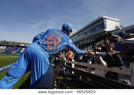 CARDIFF, WALES - June 04 2013: India's Murali Vijay signs autographs during the ICC Champions Trophy warm up match between India and Australia at the Cardiff Wales Stadium