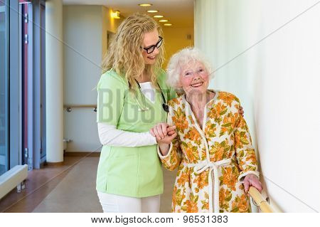 Medical Assistant Helping Happy Old Woman Walking