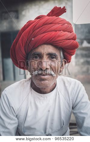 GODWAR REGION, INDIA - 12 FEBRUARY 2015: Rabari tribesman with traditional turban and clothes. Post-processed with grain, texture and colour effect.