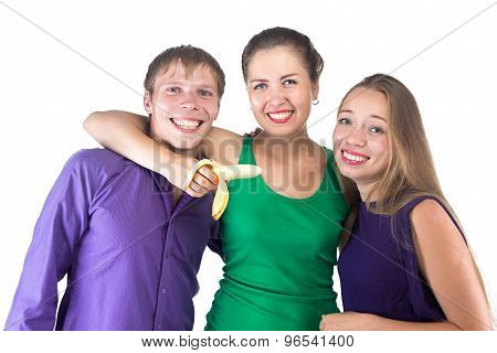 Photo of three smilimg friends with banana